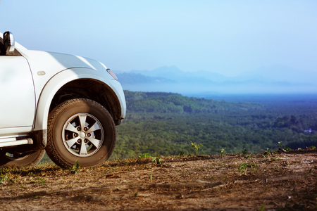 4x4 car on mountains valley backdrop Stock Photo - 77457355