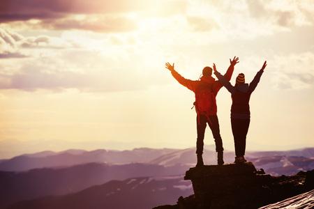Happy couple sunset winners mountain top