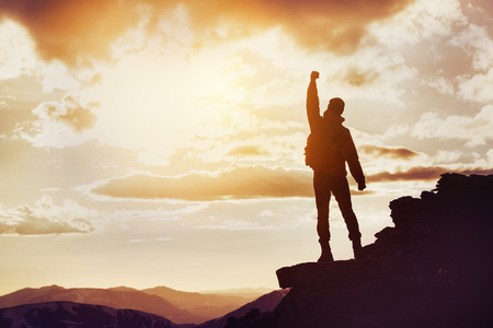 Man winner mountain top silhouette