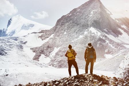 Two friends trekking mountains concept