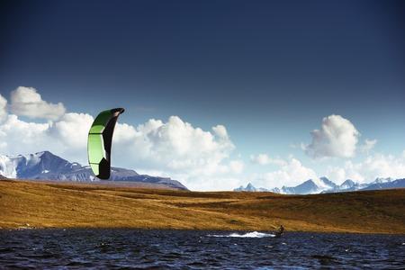 Kite surfing at mountain lake
