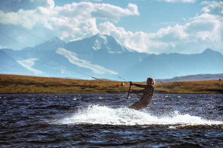 Woman kite surfing in mountain lake Stok Fotoğraf