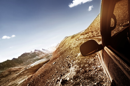 Offroad car climbing mountain pass