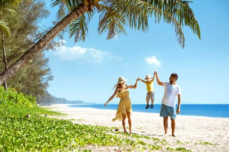 Happy family walking beach tourism Фото со стока