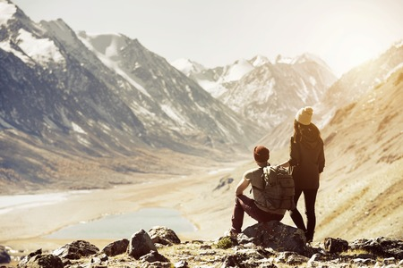 Couple trekking travel mountains concept