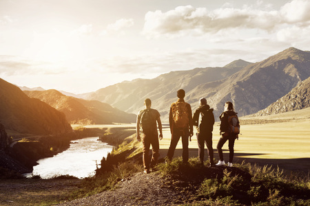 Group four people mountains travel concept Stockfoto