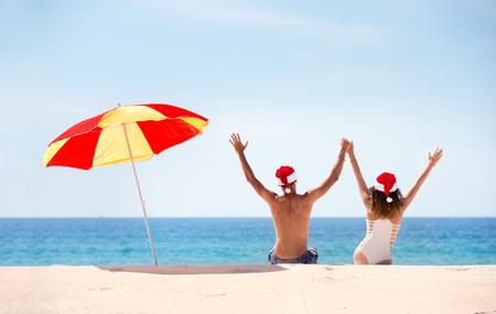 Couple with Christmas tropical beach concept