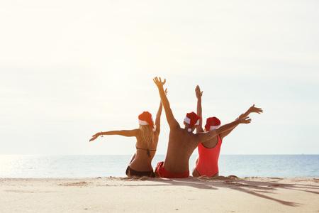 Group three friends santas hat new year concept Standard-Bild