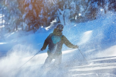 Ski concept with blurred skiers silhouette 写真素材
