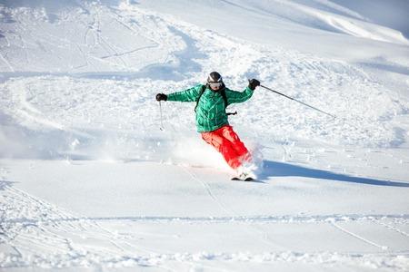 Skier offpiste freeride backcountry at snow powder