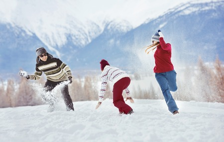 Happy friends having fun winter holidays