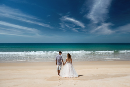 Wedding couple at idyllic sea beach