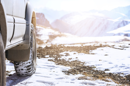 Offroad 4x4 car wheel on snow surface. Winter tires concept Stock Photo