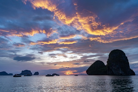 Beautiful sea sunset with cloudy sky and islands. Krabi province, Thailand, Railay or Phranang beach Stock Photo