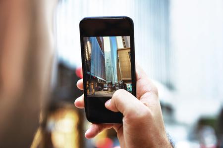 Man takes mobile photo of big city