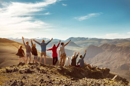 Big group of happy friends or tourists are having fun in mountains Imagens - 131676077