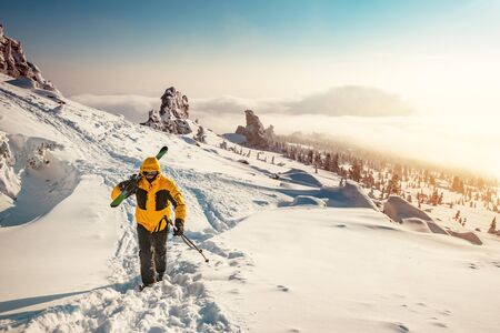 Ski tour concept with skier going uphill for backcountry freeride