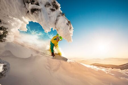 Fast snowboarder at beautiful off-piste slope. Backcountry ski or snowboarding resort concept Stok Fotoğraf