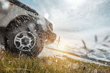 4x4 concept with car wheel and water splashes Stockfoto
