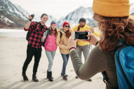 Group of happy friends hikers are taking photo together in mountains area Imagens