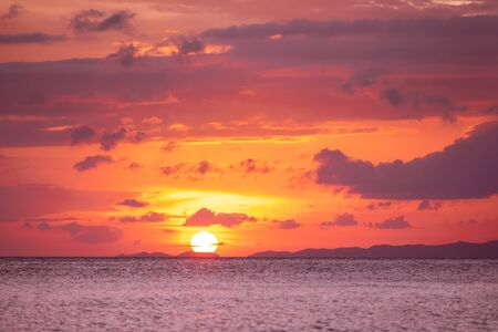 Beautiful pink sunset sky over sea bay and islands Imagens