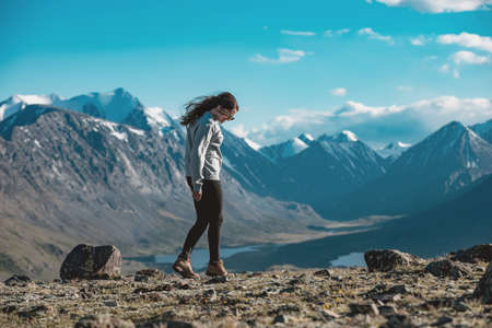 One beautiful sporty girl relax and walks in mountains