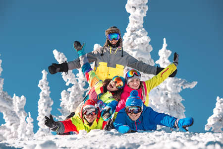 Group of five good friends are having fun at ski resort. Sheregesh, Siberia, Russia