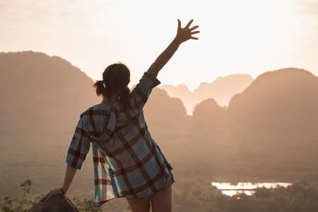 Happy slim hipster girl stands at sunrise Stockfoto