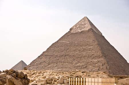 Ancient Egyptian pyramid of Giza against blue sky Archivio Fotografico