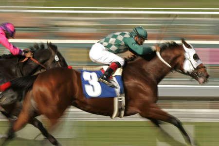 Motion Blur of Racing Jockey and Thoroughbred photo