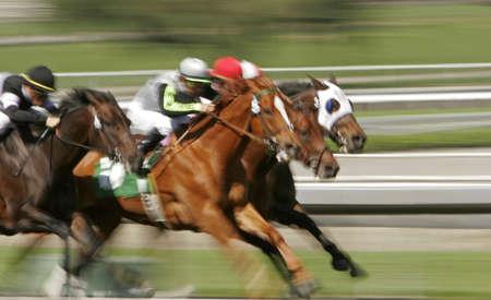 Slow shutter speed rendering of racing jockeys and horses