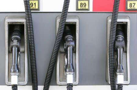 Three gasoline pumps at gasoline station