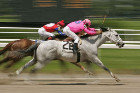 Slow shutter speed rendering of racing horses and jockeys