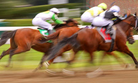 Slow shutter speed rendering of three jockeys racing their mounts to the finish line. photo