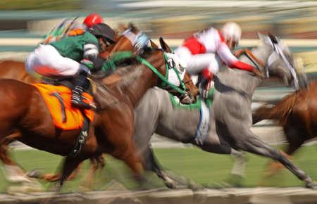Slow shutter speed rendering of racing horses and jockeys