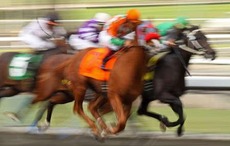 Slow shutter speed rendering of several racing jockeys and horses Stock Photo