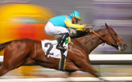 Slow shutter speed rendering of racing horse and jockey