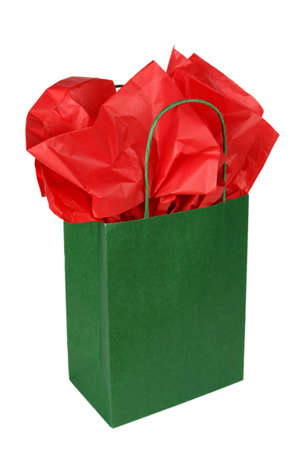 Green gift bag with red tissue isolated on white background photo