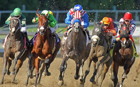 ARCADIA, CA - Two-year-old Uncle Sam (red & white stripes), under Rafael Bejarano, breaks his maiden at Santa Anita Park on Dec 27, 2010 in Arcadia, CA.