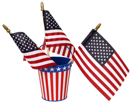 Red, white, and blue sand pail with three American flags, isolated on white.