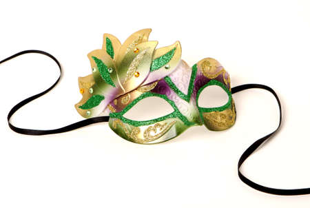 Purple, Gold, and Green Venetian Mask with Black Ribbon on White Stock Photo