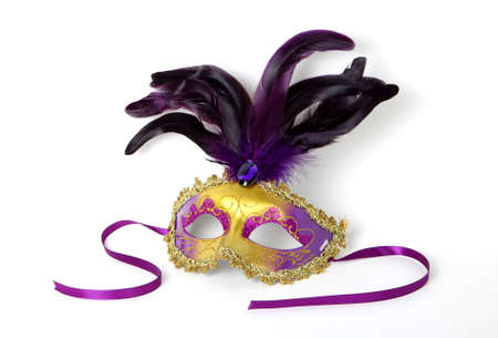 Purple and gold Venetian Mask with ribbon on white background photo