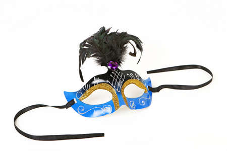 uncluttered: Festive blue Venetian Mask with Feather and Ribbon on White Background with Soft Shadow