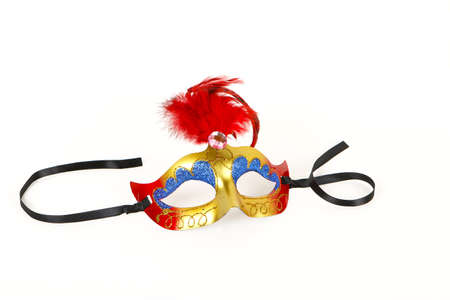 black feather: Venetian Mask with Red Feather and Ribbon on White Background with Soft Shadows