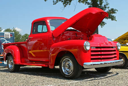 pick up: MILFORD, CT, USA - AUGUST 15, 2015: A classic red pickup truck is on display at a classic car show.