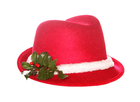 fedora: Red fedora hat decorated with fresh holly isolated and on white.