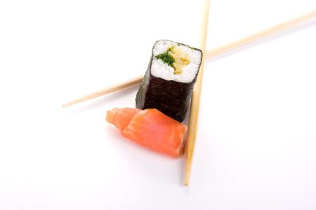 Sushi with fish and chopsticks on white.Iisolated object