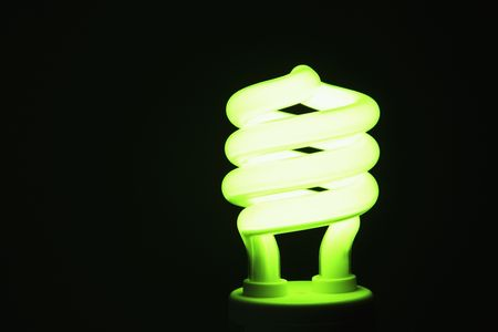 Energy saving lightbulb lighting up photo