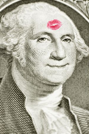 Lipstick kiss on George Washingtons forehead, George Washington smiling, money Stock Photo