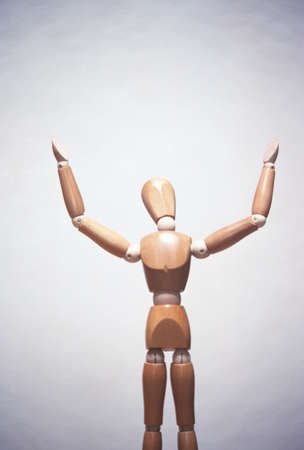 artists mannequin: Wooden artists mannequin with hands in air, concept photography